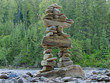 Large stacked stones Inuksuk cairn trail marker