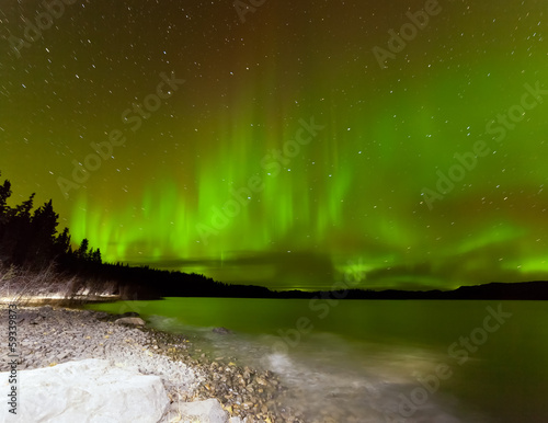 Aurora borealis night sky over Lake Laberge Yukon