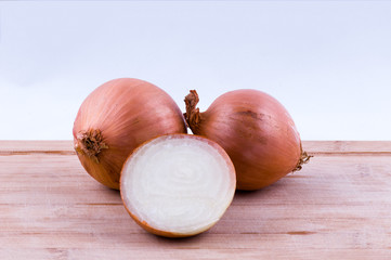 two full and one half onion on chopping board