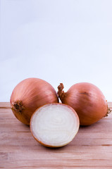 two full and one half onion on chopping board vertical