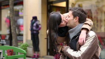 Happy couple meeting in city