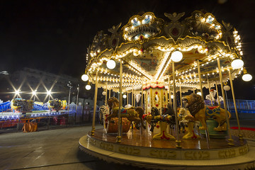 Luna park carousel in a public outdoor area