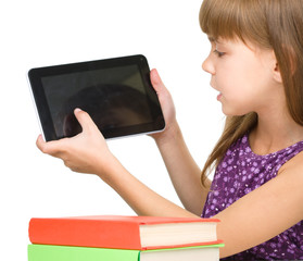 Young girl is showing tablet