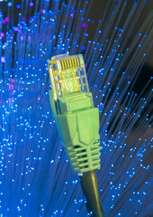 network cable closeup with fiber optical background