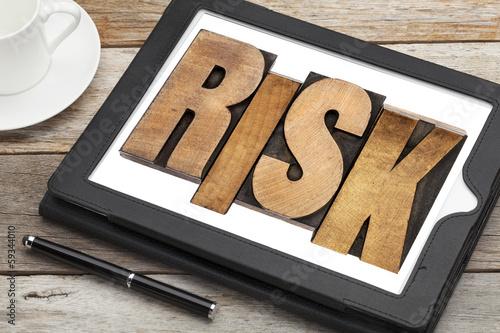 risk - word on digital tablet