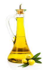 Olive oil in a glass bottle and olives isolated over a white bac