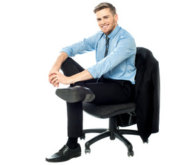 Relaxed businessman posing casually