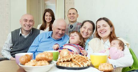 happy multigeneration family communicate around tea