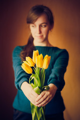Young woman girl holding flowers