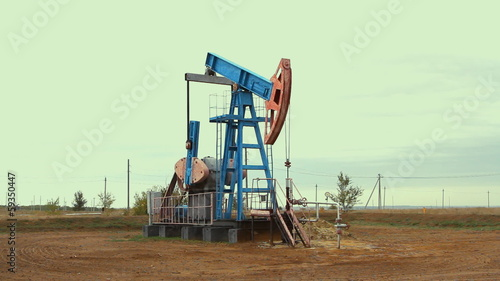 Work of oil pump jack on a oil field.