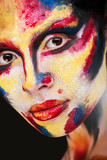 beautiful young girl with paint on his face