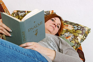 Woman with holly book.