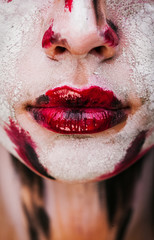 Lips of beautiful young girl with paint on his face