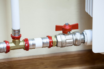Central heating radiator with opened valve on pipe