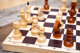 Chess pieces on wooden board table