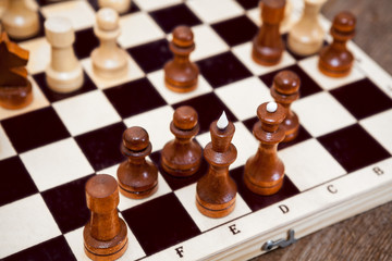 Close up view chess pieces on wooden board table
