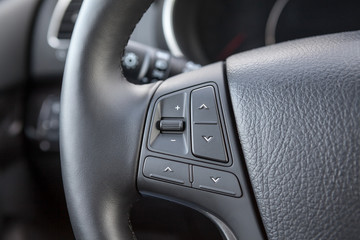 Control buttons on the steering wheel of a car