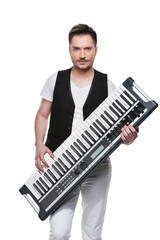 Sexy handsome man with synthesizer.