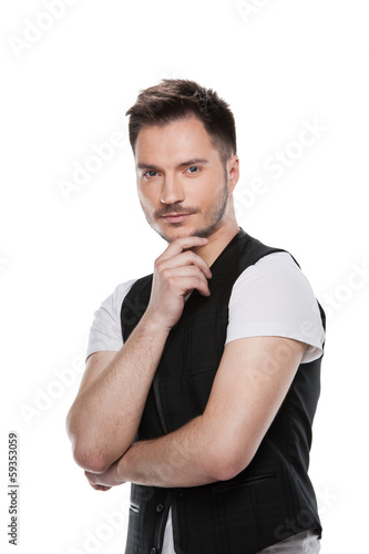 Portrait of Handsome male model posing on camera.