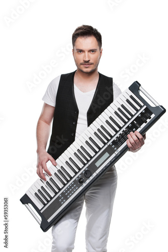 Sexy handsome man with synthesizer. © BlueSkyImages
