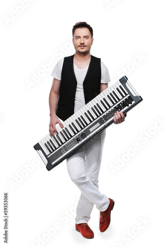 Full length of male musician with synthesizer © BlueSkyImages