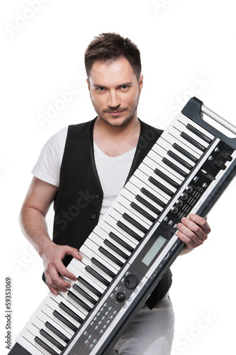 Portrait of sexy mature man with piano keyboard. © BlueSkyImages