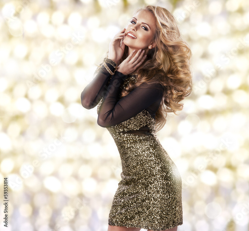 Beauty woman in gold dress