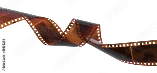 Curled film ribbon isolated on white