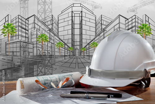 safety helmet and architect pland on wood table with sunset scen - 59357889