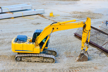 Yellow excavator on a construction site