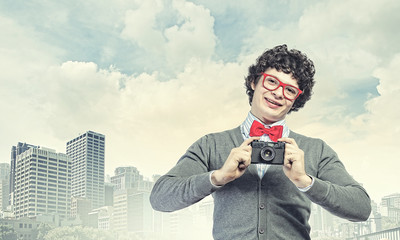 Young man with photo camera