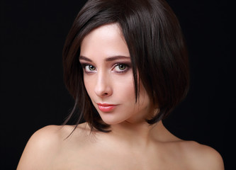 Beautiful sexy woman with green eyes and short hair looking