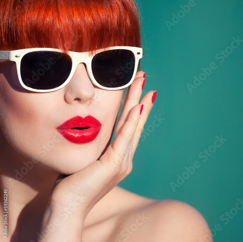 Colorful summer portrait of an attractive young woman