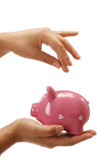 Female hands holding a piggybank empty space to insert a coin