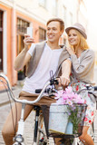 couple with bicycles and smartphone in the city