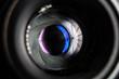 Leinwandbild Motiv Camera lens close-up on black background