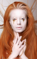 Masquerade. Redhead Woman with Futuristic Make-up. Fantasy