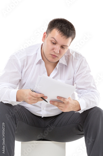 Businessman reading a report with scepticism