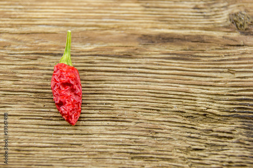 chili pepper on wood background