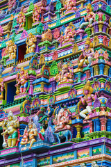 Colorful wall and figures on the facade of Hindu temple in