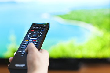 Hand with television remote control