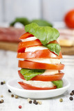 Italian cuisine: caprese salad and breadsticks with ham