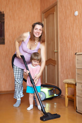 Family chores with vacuum cleaner in home