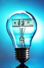 Light bulb with dollar on blue background