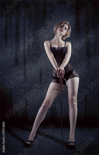 Woman with sword studio shot