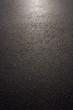 canvas print picture - Hintergrund nasser Asphalt im Gegenlicht