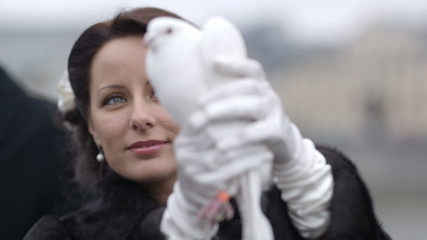 Bride with pigeon.