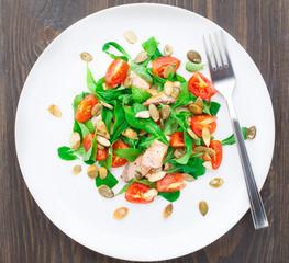 Salad with arugula, salmon and cherry tomato