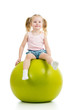 Child having fun with  gymnastic ball isolated