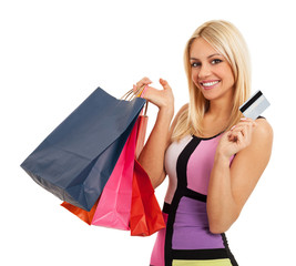 Attractive blonde with shopping bags and credit card